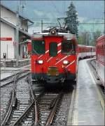 Diverses/8245/im-stroemenden-regen-faehrt-ein-mgb Im strömenden Regen fährt ein MGB Regio in Fiesch ein. 01.08.08 (Hans)
